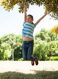 Cute little girl jumping up stock image