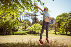 Cute little girl jumping up Royalty Free Stock Photography