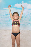 Cute little girl jumps on beach. Summer, sun, sea, vacation, childhood concept Royalty Free Stock Photo
