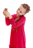 Cute little girl keep before our eyes fluffy Stock Photo