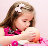 Cute little girl kissing her doll Stock Photo