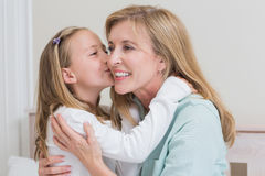 Cute little girl kissing her mother Royalty Free Stock Image