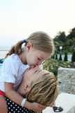 Cute little girl kissing her mother's nose Royalty Free Stock Images