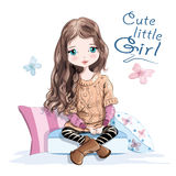 Cute little girl in knitted sweater and skirt sitting on soft pillows. Beautiful young girl with long hair. Hand drawn girl. Stock Images