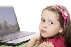 Cute little girl with the laptop Stock Images