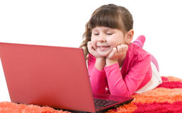 Cute little girl with laptop Royalty Free Stock Photography