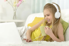 Cute little girl with   laptop Royalty Free Stock Photo
