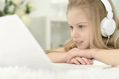 Cute little girl with   laptop Stock Images