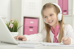 Cute little girl with   laptop Stock Image