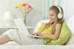 Cute little girl with   laptop Stock Photography