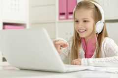 Cute little girl with   laptop Stock Photos