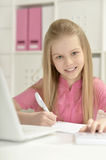 Cute little girl  and  laptop Royalty Free Stock Photography