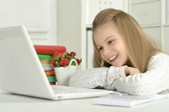 Cute little girl  and  laptop Stock Photography