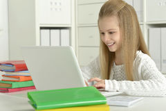 Cute little girl  and  laptop Royalty Free Stock Photos