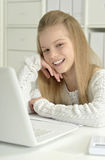 Cute little girl  and  laptop Stock Image
