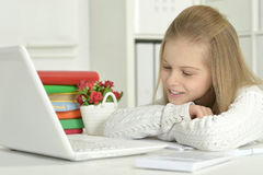 Cute little girl  and  laptop Royalty Free Stock Photo