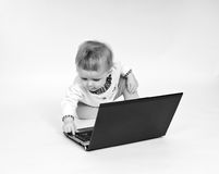Cute little girl with laptop isolated on white Stock Images