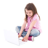 Cute little girl with laptop isolated on white Stock Photo
