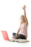 Cute little girl with laptop, raising her hand Royalty Free Stock Photo