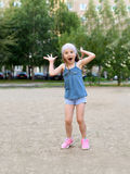 A cute little girl laughing and making faces cute little girl royalty free stock images