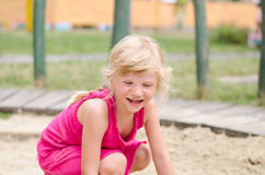 Cute little girl laughing stock images