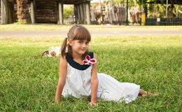 Cute little girl on the lawn Stock Images