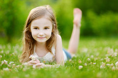 Cute little girl laying in the grass stock photos