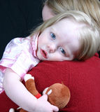 Cute little girl laying head stock photo