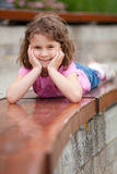 Girl laying on a bench Stock Photo