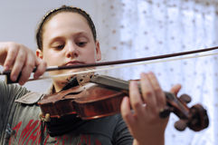Cute little girl learn viola lesson Stock Photography