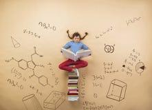 Cute little girl learning stock photo