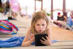 Cute little girl learning with tablet pc Stock Images