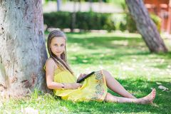 Cute little girl learning with tablet pc Stock Photo