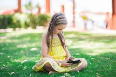 Cute little girl learning with tablet pc Royalty Free Stock Photography