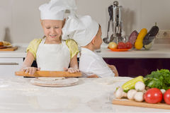 Cute little girl learning to bake Royalty Free Stock Image