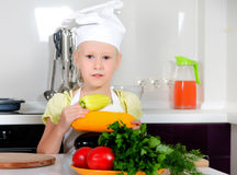 Cute little girl learning to be a chef Royalty Free Stock Photos
