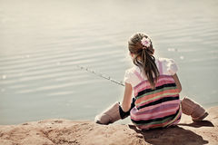 Cute little girl learning to fish Royalty Free Stock Photo