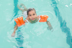 Cute little girl learning to swim Royalty Free Stock Photos