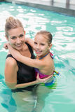 Cute little girl learning to swim with mum. At the leisure center Royalty Free Stock Photography