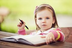 Cute little girl learning to write Royalty Free Stock Image