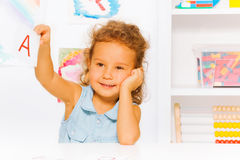 Cute little girl with letter card reading lesson Royalty Free Stock Photo