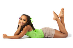 Cute little girl lie on the floor. Isolation on white background stock photo