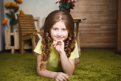 Cute little girl lie on the grass Royalty Free Stock Photo