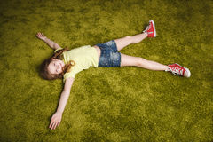 Cute little girl lie on the grass Stock Photography