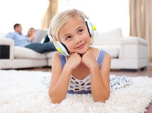 Cute Little Girl Listening Music Lying On The Flo Royalty Free Stock Image