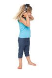 Cute little girl listening to music and dancing. On white background Royalty Free Stock Photos