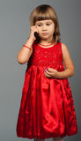 Cute little girl listening to the phone Stock Photography