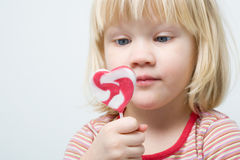 Cute little girl with a lollipop Royalty Free Stock Photography