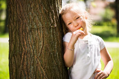 Cute Little Girl with Lollipop Stock Photo