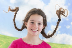 Cute little girl with long braided hair up Stock Photo